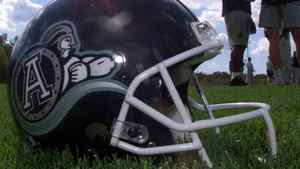 A helmet lies on the grass at a Toronto Argonauts practice. FRANK GUNN/The Canadian Press