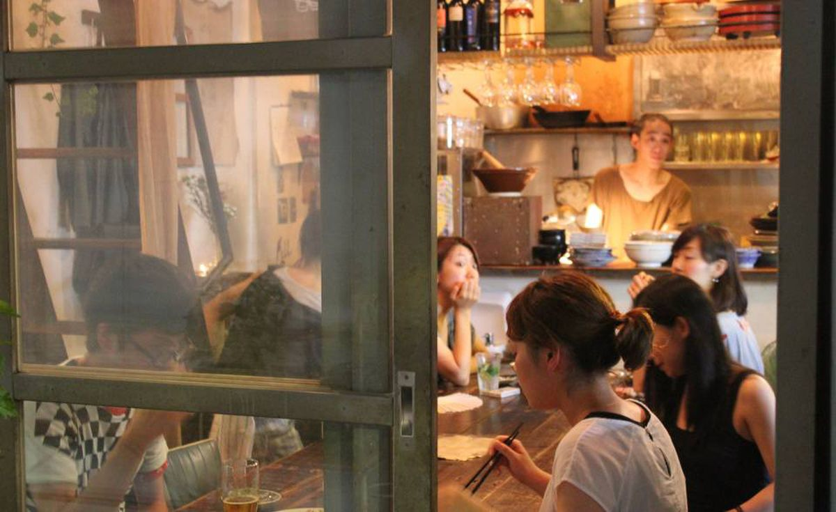 Inside Usaya, with its communal table and open kitchen.