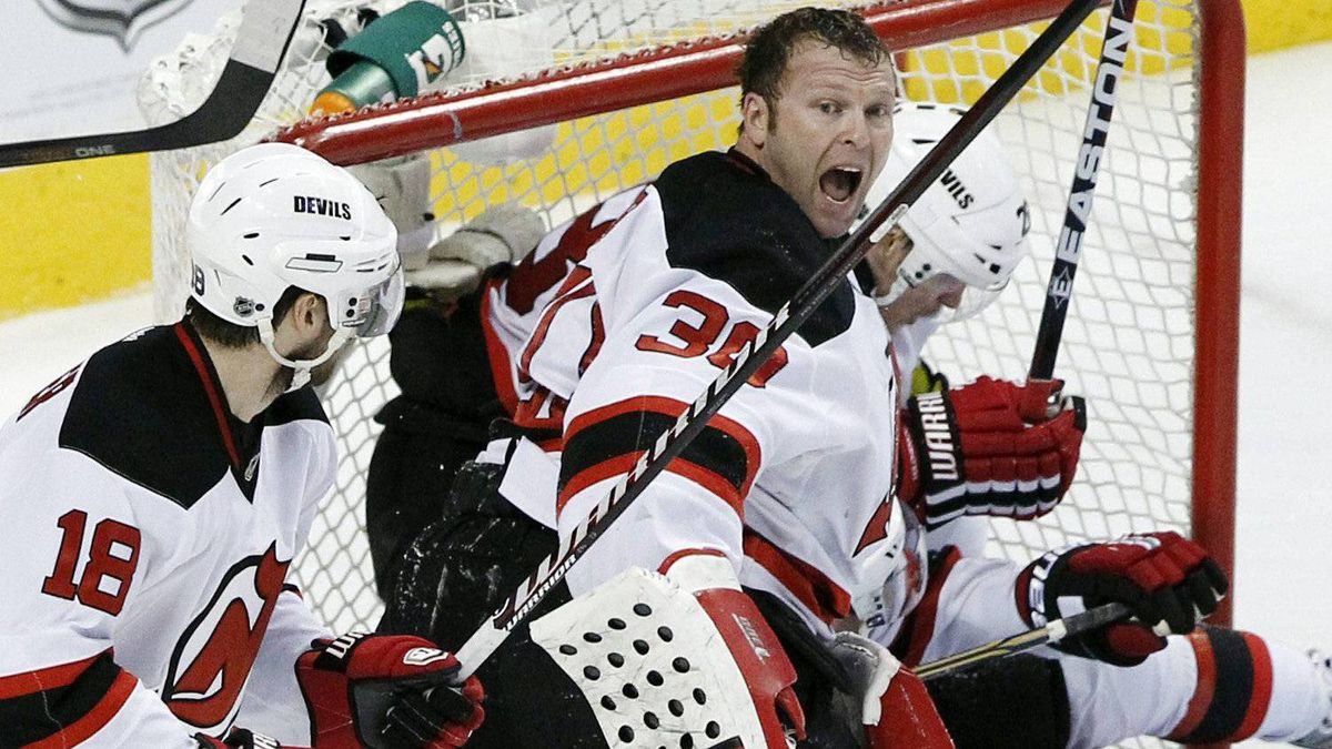 New Jersey Devils goalie Martin Brodeur (30) reacts after losing his helmet in a collision with his teammates in the third period of Game 1 in a second-round NHL Stanley Cup hockey playoff series with the Philadelphia Flyers, Sunday, April 29, 2012 in Philadelphia. The Flyers won 4-3 in overtime. (AP Photo/Alex Brandon)