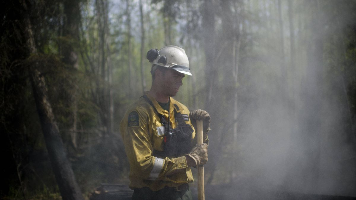 Wildfire Ranger with Alberta Sustainable Resource Development Jason McAleenan, part of a strike team, puts out hot-spots near the site of the point of origin for the fire around Slave Lake, Alberta on May 19, 2011.