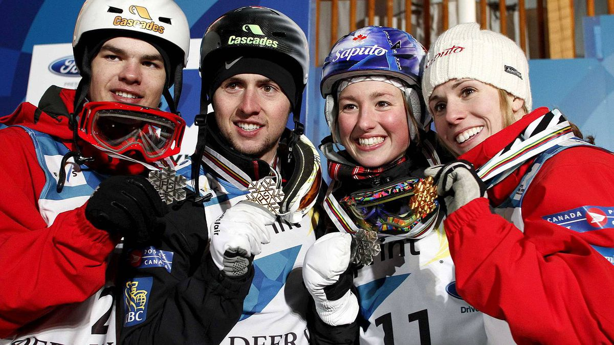 Canadian teammates second-placed Mikael Kingsbury, first-placed Alexandre Bilodeau, second-placed Chloe Dufour-Lapointe and first-placed Jennifer Heil, hold their medals after the dual moguls final at the FIS Freestyle Ski World Championships in Park City, Utah February 5, 2011.