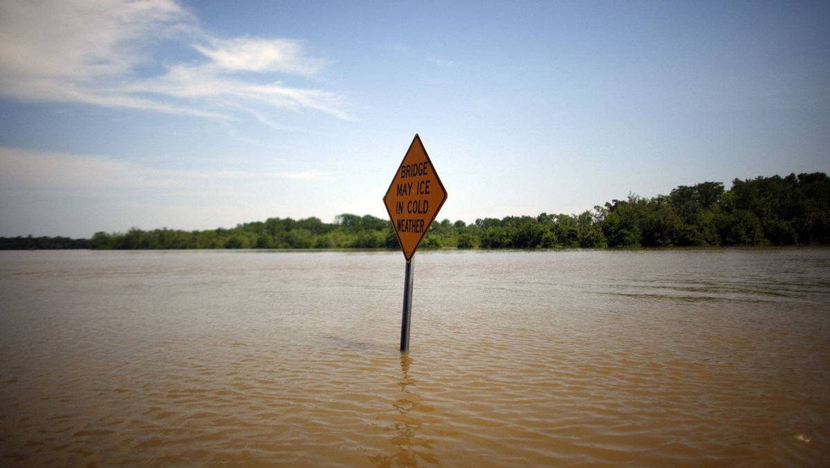 A sign is seen on a road as floodwaters slowly rise in Holly Grove, Arkansas May 10, 2011. The Mississippi River may have reached its highest level at Memphis early on Tuesday just inches below the all-time record.