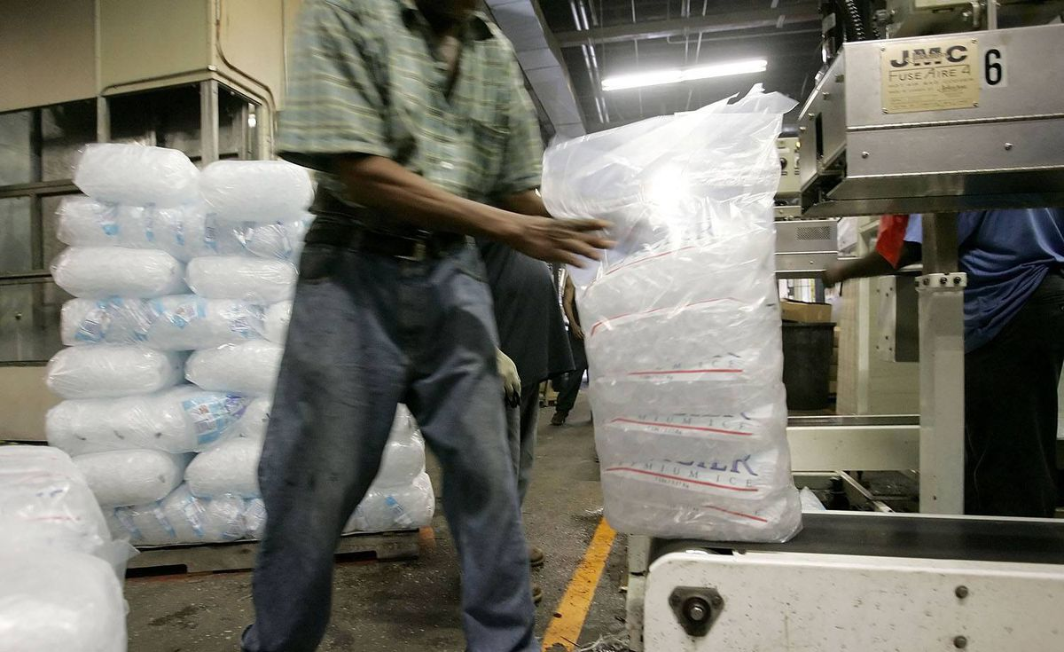 Bags of ice come off a conveyer to be placed on pallets at the Losquardo/Arctic Glacier Ice Company in New York City.