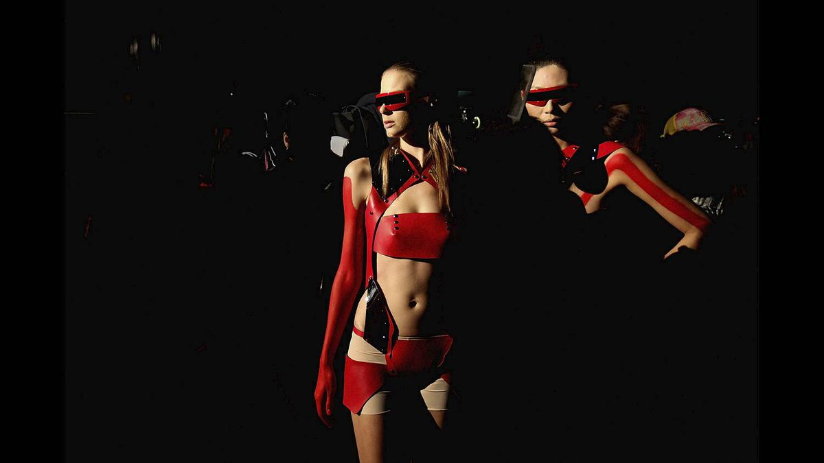 Two models prepare for the Bobaolon 2011 Global Fashion Arts Designing Contest of Academy Elite show on day five of China Fashion Week A/W 2011 on March 28, 2011 in Beijing, China.