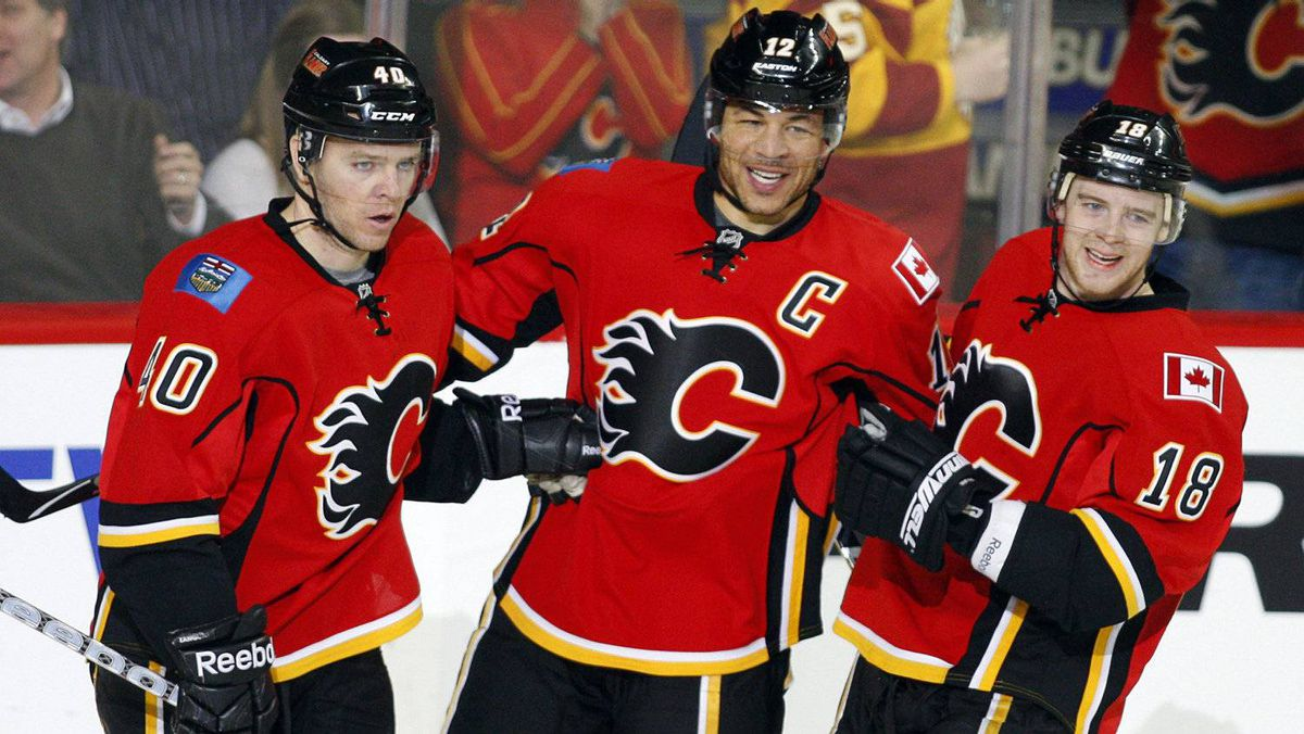 Calgary Flames' Jarome Iginla, centre, celebrates his goal with teammates Alex Tanguay, left, and Matt Stajan during second period NHL hockey action against the Phoenix Coyotes in Calgary, Alta., Thursday, March 15, 2012.
