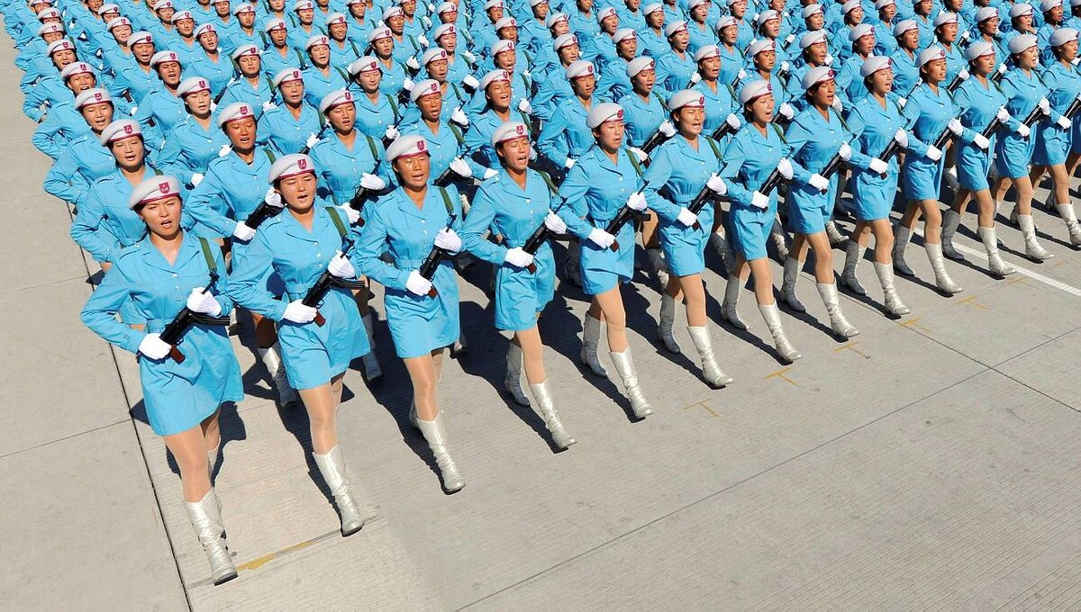Female members of a Chinese militia march in formation during a training session for the 60th National Day Parade Village on the outskirts of Beijing on Sept. 15, 2009.
