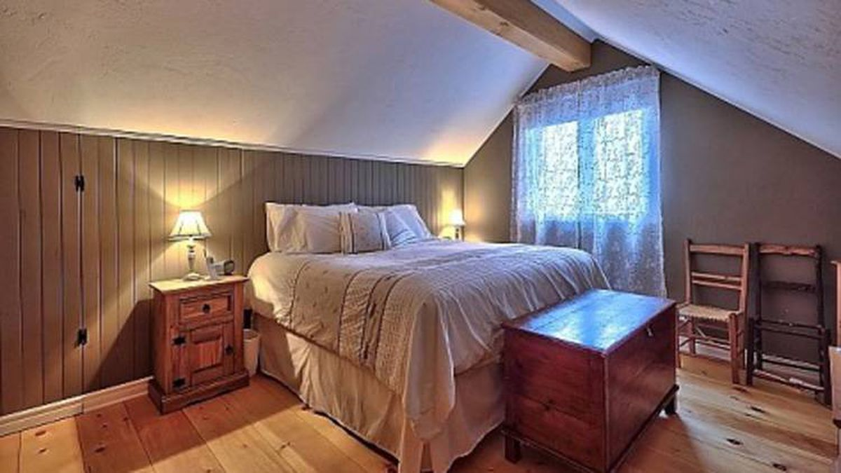 The bedrooms feature hardwood flooring and beams.
