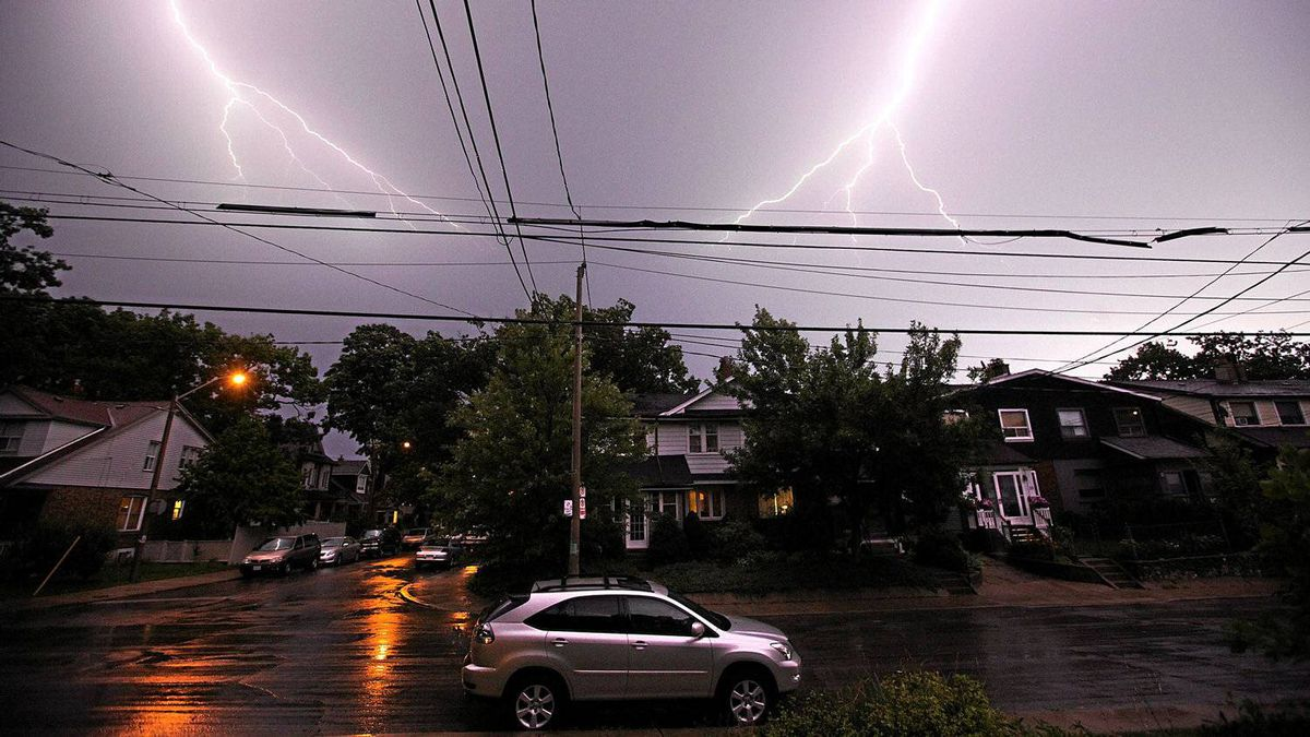 Lightening lights up the night sky in an east end neighbourhood on Aug. 24, 2011 during a severe thunderstorm warning and a tornado watch in Toronto, Ontario, Canada.