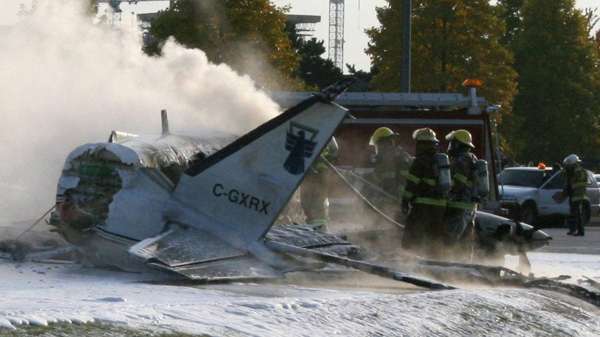 Firefighters attend the scene of a plane crash in Richmond, B.C. on Thursday Oct. 27, 2011.