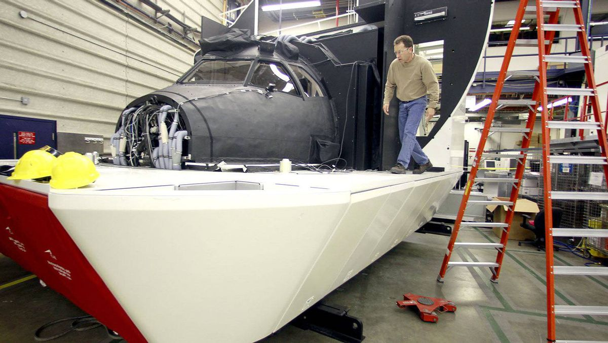 Hans Silvani works on a simulator at CAE Inc., in Montreal, Quebec, April 21, 2010.