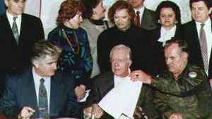 Former U.S. president Jimmy Carter, Bosnian Serb leader Radovan Karadzic and Bosnian Serb Army Commander Ratko Mladic sign an agreement on Dec. 19, 1994, for an immediate four-month ceasefire.