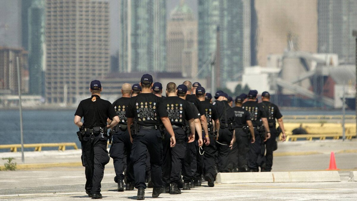 Police officers march in preparation for G-20 summit at the old ferry terminal on Cherry Beach in June, 2010.