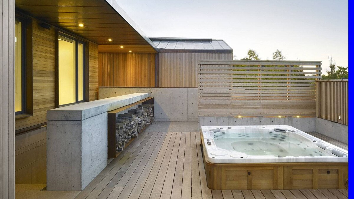 The architects say their clients 'wanted to make it a place for play.' That included a large outdoor whirlpool hot tub and an elaborate basement spa.