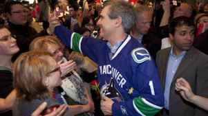 Liberal leader Michael Ignatieff sports a Vancouver Canucks jersey following a townhall meeting during a campaign stop in North Vancouver, B.C. Sunday, April 17, 2011. THE CANADIAN PRESS/Jonathan Hayward
