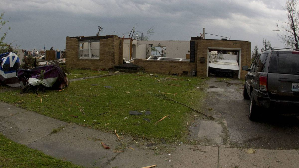 A damaged house is seen on 15th Street and Rangeline road in Joplin, Missouri May 22, 2011 after a tornado hit the town.