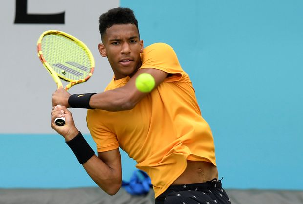Auger-Aliassime ousts top seed Tsitsipas at Queen's