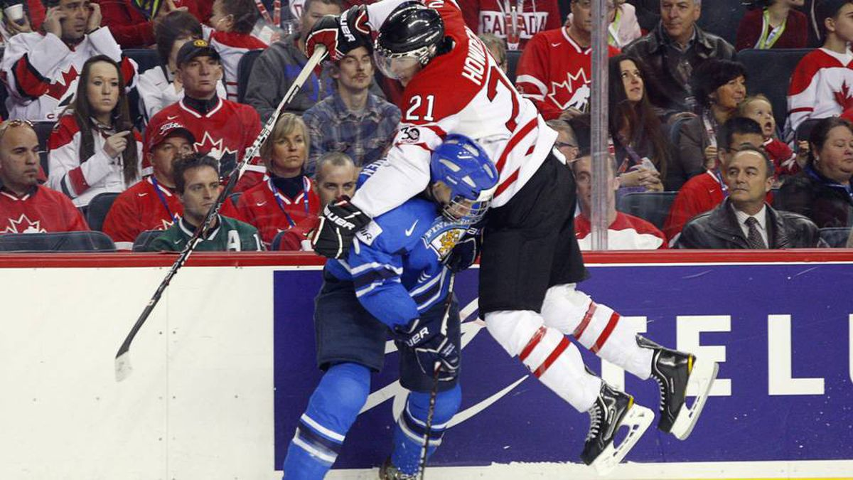 Team Canada's Quinton Howden, right, tries to go over Finland's Rasmus Ristolainen during the second period.