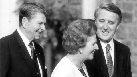 U.S. President Ronald Reagan, British Prime Minister Margaret Thatcher and Prime Minister Brian Mulroney chat at a G7 leaders' summit on June 20, 1988.