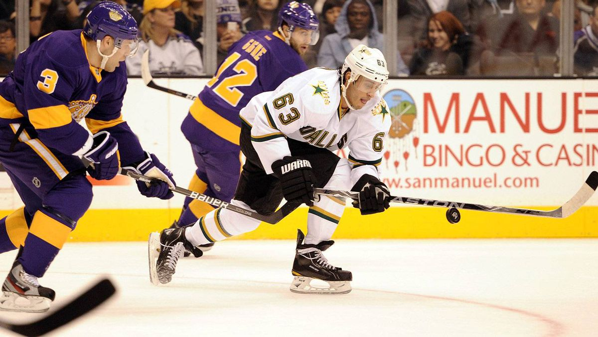 Mike Ribeiro #63 of the Dallas Stars chases the puck in front of Jack Johnson #3 and Simon Gagne #12 of the Los Angeles Kings during the first period at Staples Center on December 10, 2011 in Los Angeles, California. (Photo by Harry How/Getty Images)