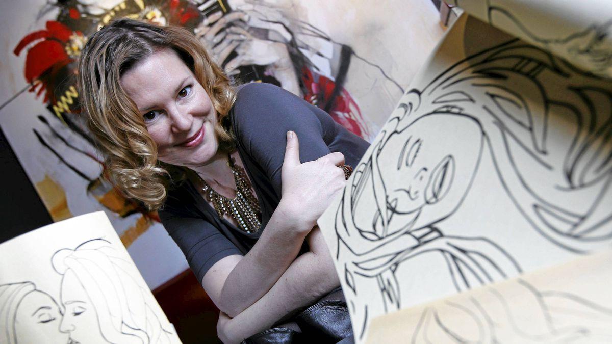 Mia Nielsen with some work by local artist Mallory Diaczun