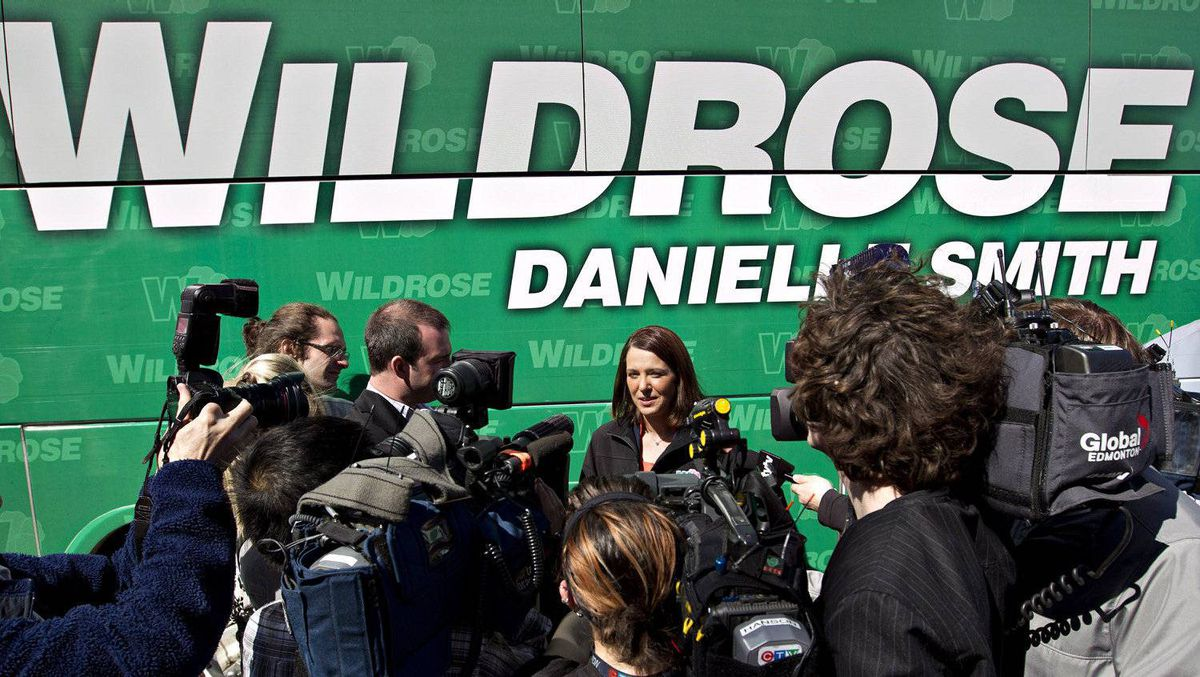 Wildrose Leader Danielle Smith speaks to media by her bus during a campaign stop at the Dow Centennial Centre trade show in Fort Saskatchewan, Alta., on April 21, 2012.