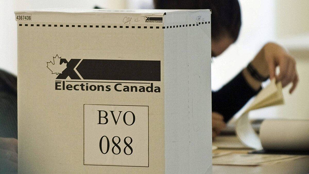 An Elections Canada official waits for voters to cast their ballots at a Montreal polling station on May 2, 2011.