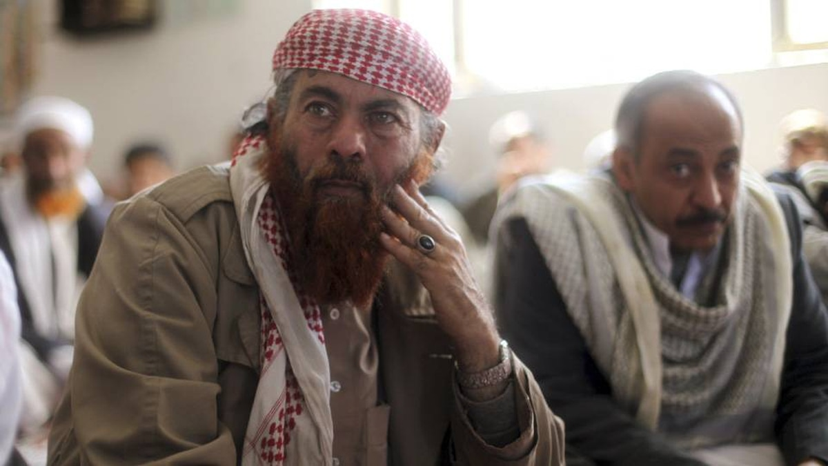 Saleh Al Zoba, a 60-year-old Yemeni formerly imprisoned at Guantanamo Bay, attends Friday prayers at a mosque in Sanaa. U.S. President Barack Obama this week suspended the repatriation of Yemeni detainees from Guantanamo.