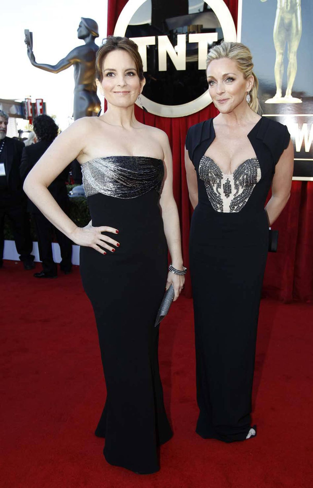 Tina Fey drives a convertible and Jane Krakowski rides a motorbike at the SAG awards in Los Angeles on Sunday.
