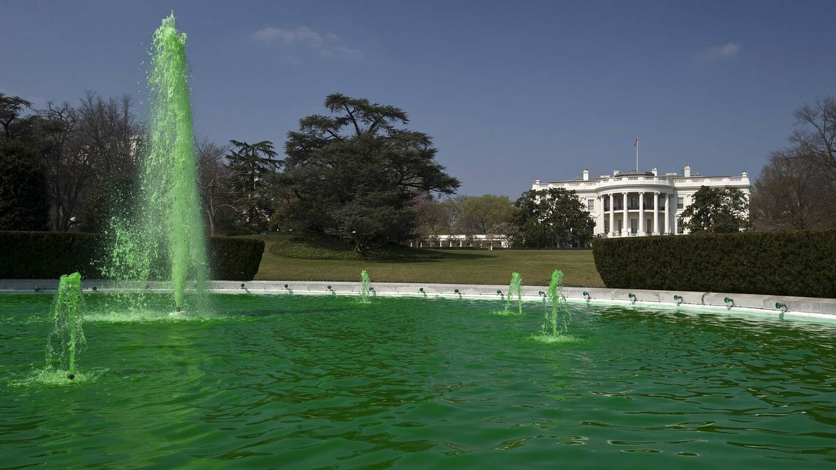 Dyed green water fills the South Lawn Fountain at the White House on Saturday.