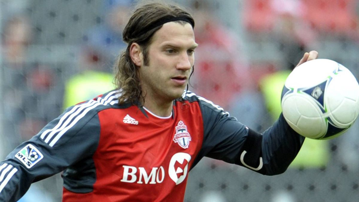 Toronto FC's Torsten Frings knocks down a ball during the first half of their MLS soccer match against the Chicago Fire in Toronto April 21, 2012. REUTERS/ Mike Cassese