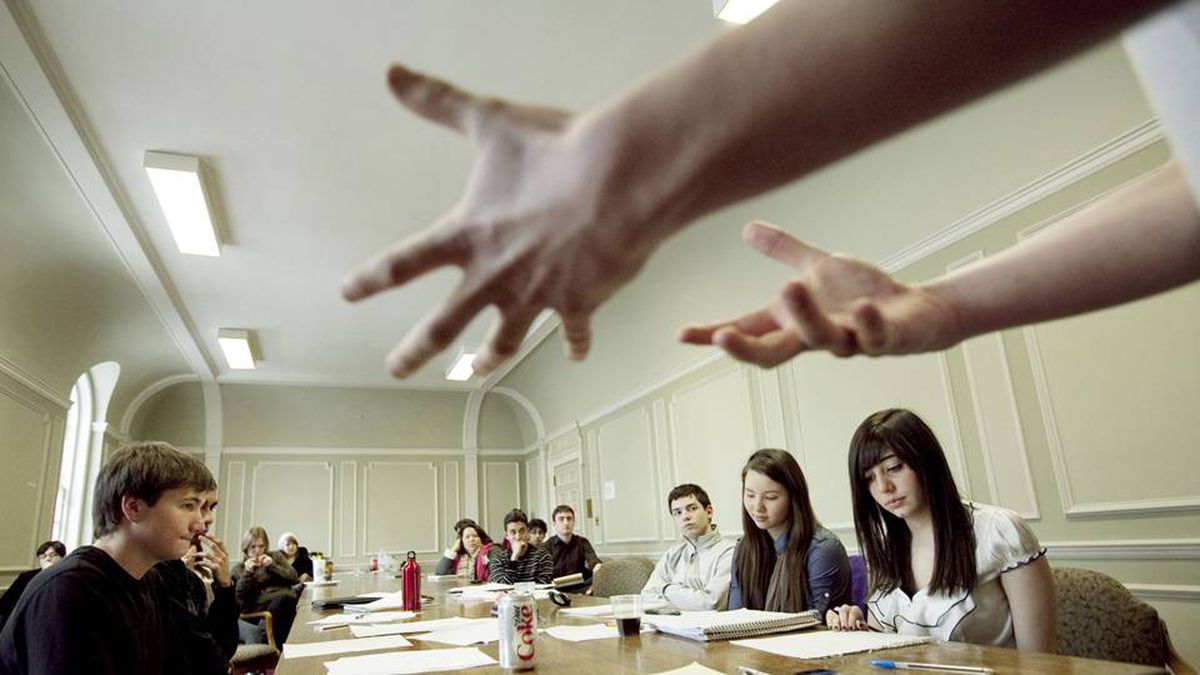Keenan MacNeal, presents his argument to his teammates Lyle Dobbin, Veenu Goswami, Andrew Morrison Sophie Bird and Sarah Levy during a Team Canada high school debate team practice at the University of Toronto on February 4, 2010.