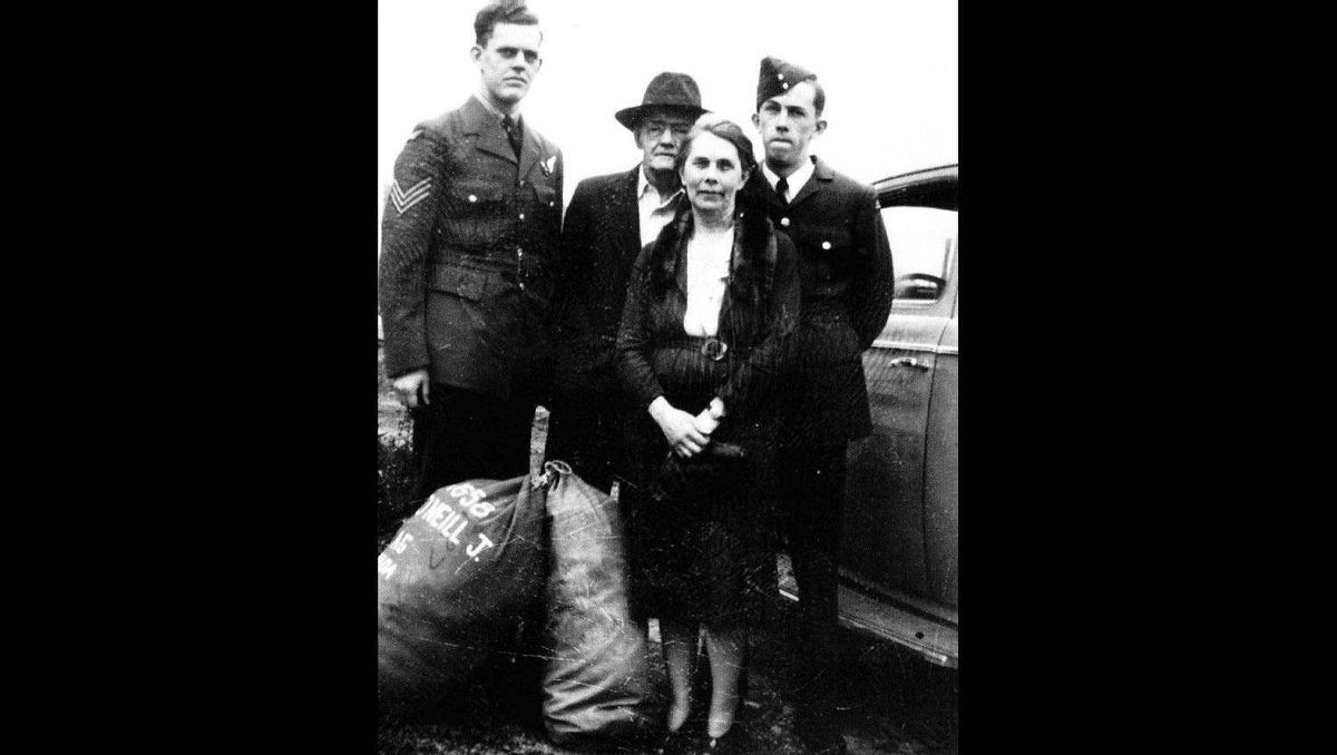 (From left to right) John Joseph Hugh (Mickey) O'Neill, Irene and John O'Neill and Cliff O'Neill are pictured as John Joseph Hugh O'Neill prepares for departure overseas in Thorold, ON c. 1943