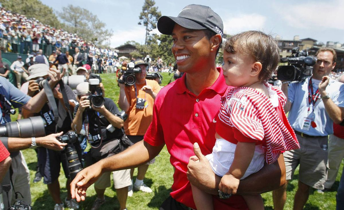 Tiger Woods walks with his daughter Sam Alexis after his win in the playoff round of the U.S. Open golf championship at Torrey Pines in San Diego on June 16, 2008.