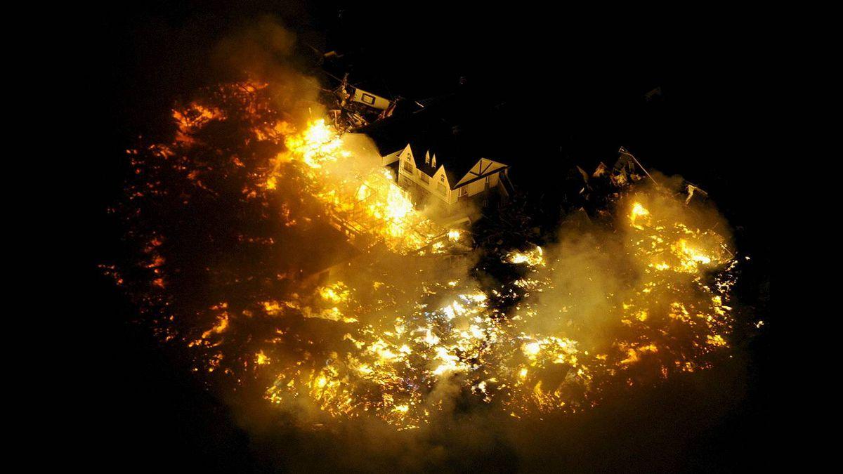 Buildings burn after an earthquake near Sendai Airport, northeastern Japan