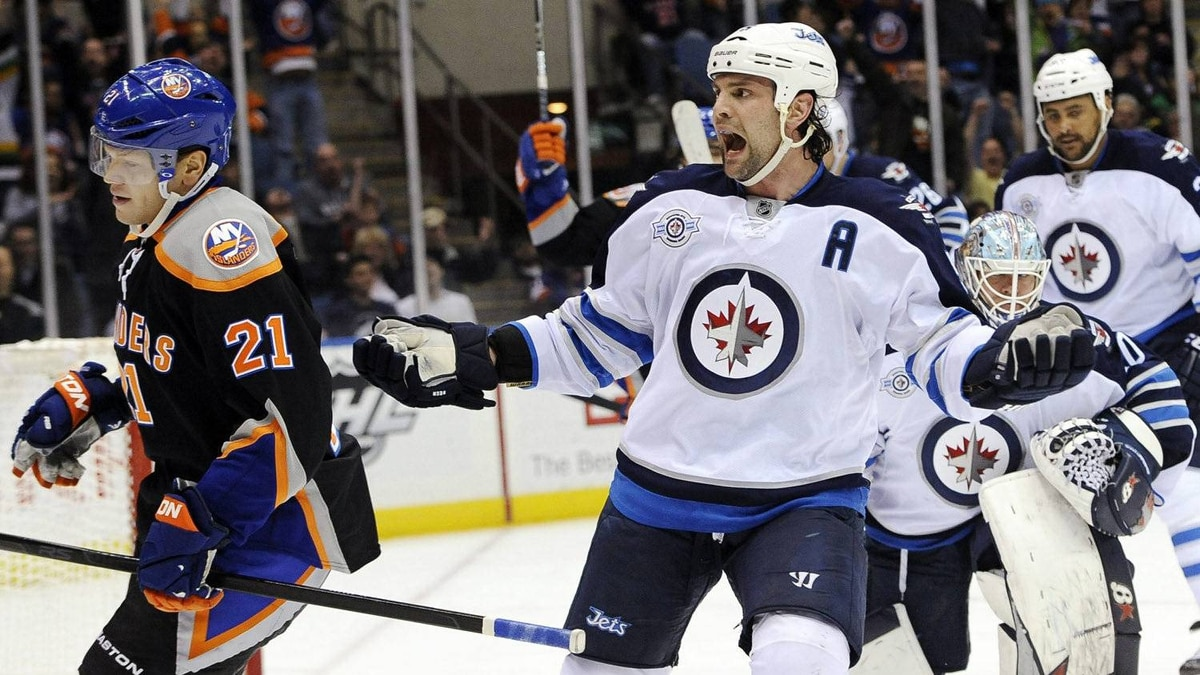 Winnipeg Jets' Mark Stuart reacts after New York Islanders' Kyle Okposo (21) scored against Jets goalie Chris Mason (50) in the second period of an NHL hockey game on Thursday, April 5, 2012, in Uniondale, N.Y. (AP Photo/Kathy Kmonicek)