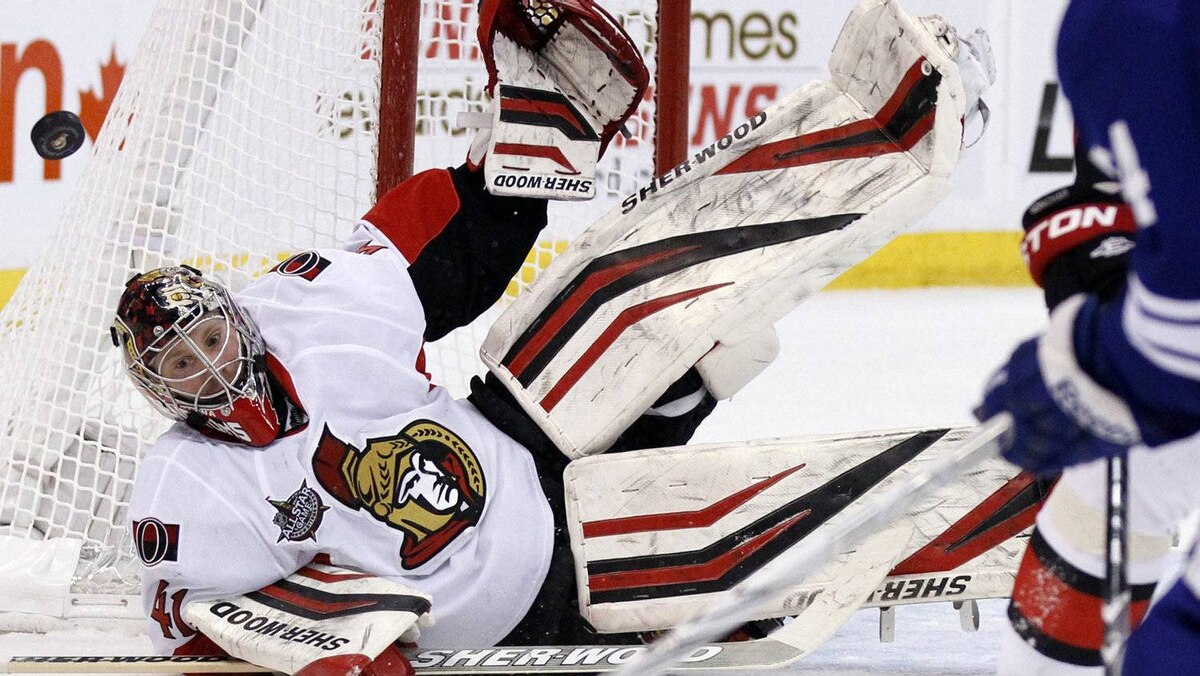 Ottawa Senators goalie Craig Anderson dives to stop a shot against the Leafs on Feb. 4, 2012.