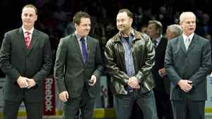 Hockey Hall of Fame inductees Joe Nieuwendyk, left, Doug Gilmour, second left, Ed Belfour, second right, and Mark Howe take part in a ceremony before the Toronto Maple Leafs take on the Ottawa Senators in NHL hockey action in Toronto on Saturday, Nov. 12, 2011. THE CANADIAN PRESS/Nathan Denette