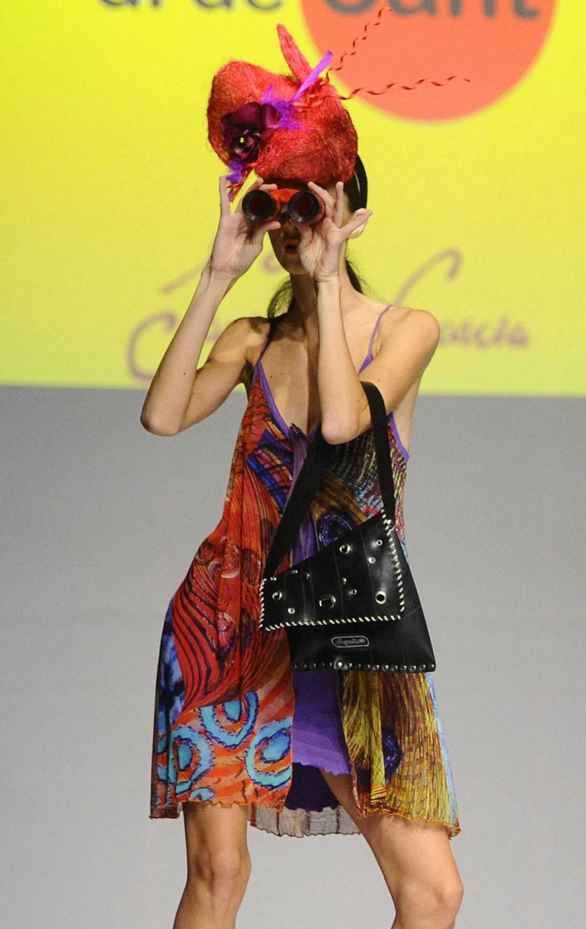 A model presents a creation by Spanish designer Santiago Gonzalez during the Pasarela Castilla y Leon spring/summer 2012 fashion show in Burgos, northern Spain, October 5, 2011.