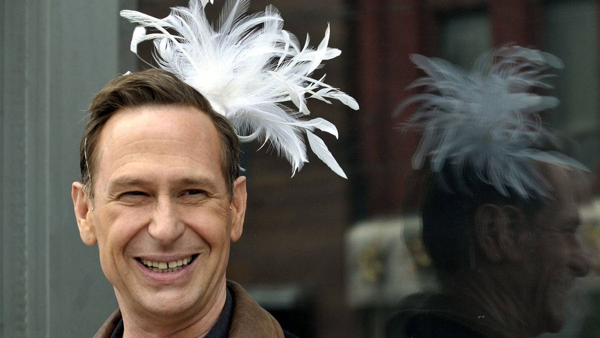 In this April 2011 file photo, comedian Scott Thompson wears a feather tiara after suggesting Drag Day as his big idea for Toronto.