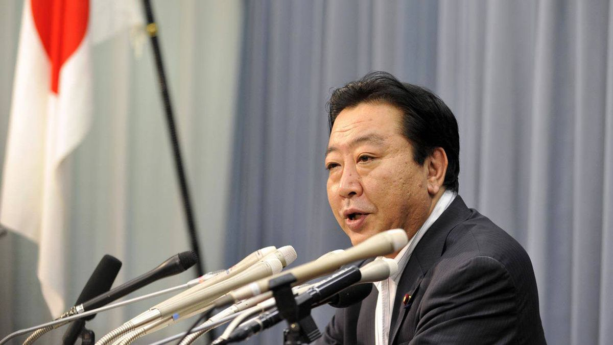 Japanese Finance Minister Yoshihiko Noda announces a $100-billion facility to help ease the impact of the strong yen on Japanese companies at a press conference at his office in Tokyo on Aug. 24, 2011.
