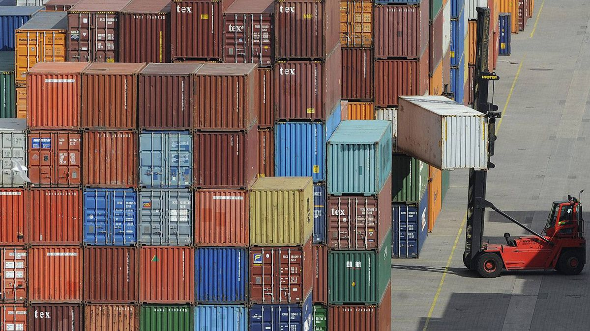 """File photo of containers being loaded at a terminal of the """"Hamburger Hafen und Logistik AG"""" (HHLA) in the harbour of Hamburg, northern Germany."""