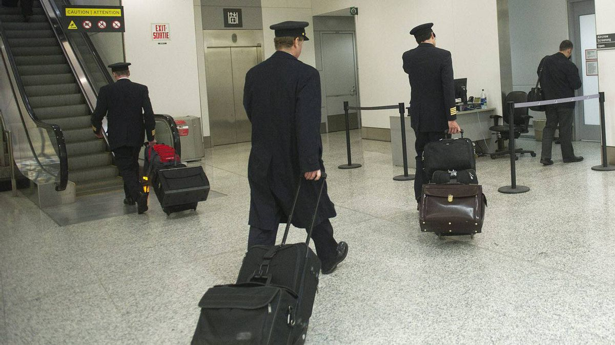 Air Canada pilots head to work as at Pearson International Airport in Toronto on Thursday, March. 8, 2012.