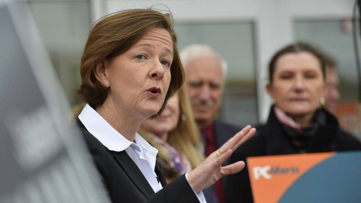 Alberta premier Alison Redford answers questions during a news conference during a campaign stop in Calgary, Alberta, April 4, 2012.