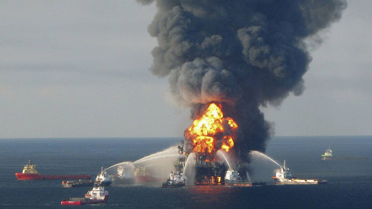 Fire crews battle the blazing remnants of offshore oil rig Deepwater Horizon in this April 21, 2010 file image. The U.S. Justice Department has charged an ex-BP engineer with destroying evidence.