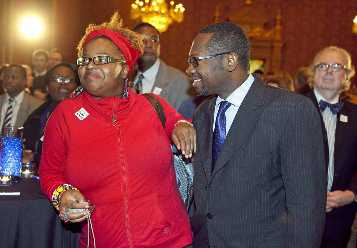 Poet and performer Oni The Haitian Sensation listens in with Jeancois Joseph of the Haitian embassy to Canada.