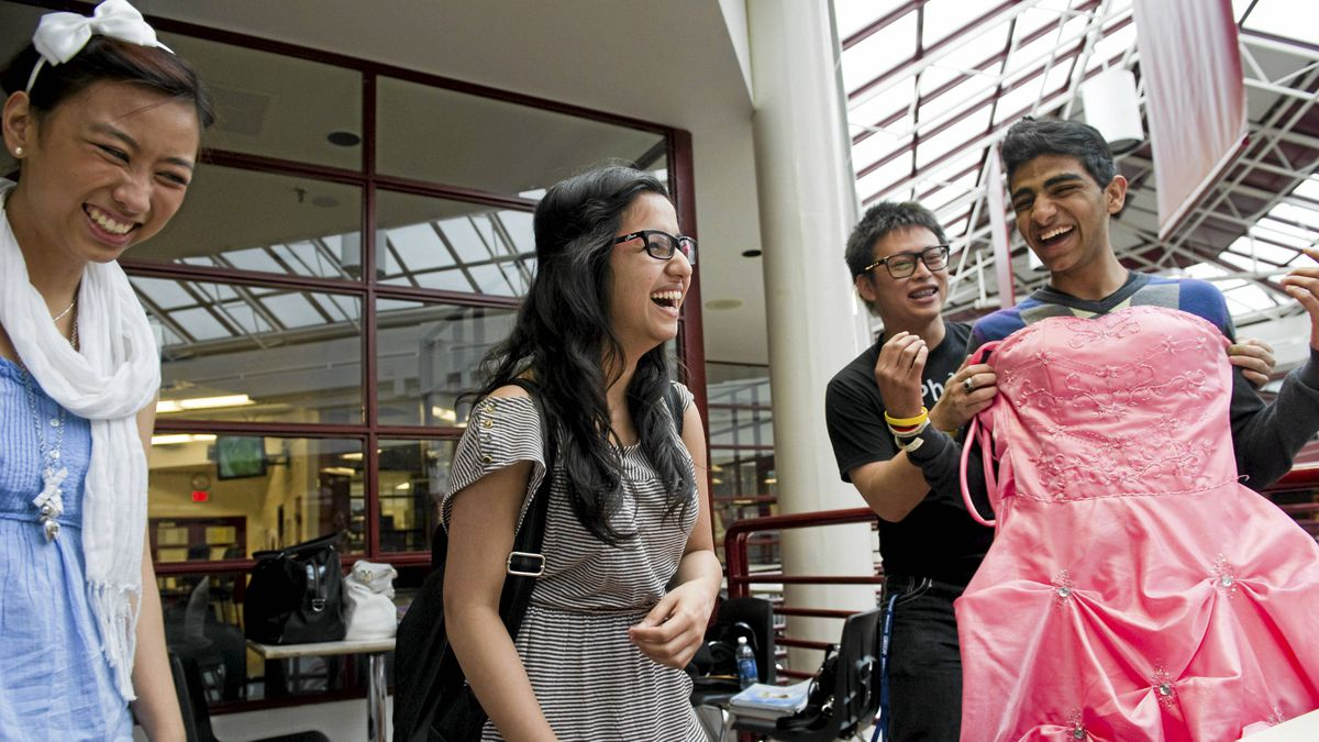 Ashima Chandan (centre and her friends (l-r) Kathryn Lacanaria Doan Tran, and Shah Gilani talk about their prom after school at J. Percy Page High School in Edmonton on Friday, June 3, 2011.