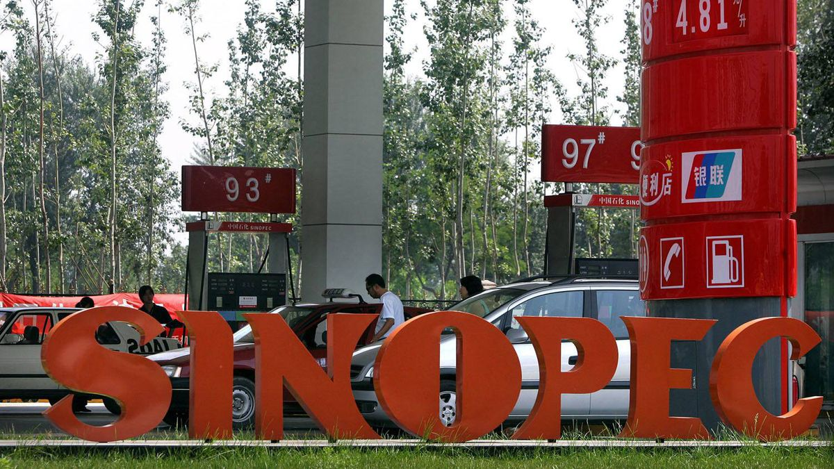Cars are filled up at a Sinopec gas station in Beijing in this file photo.