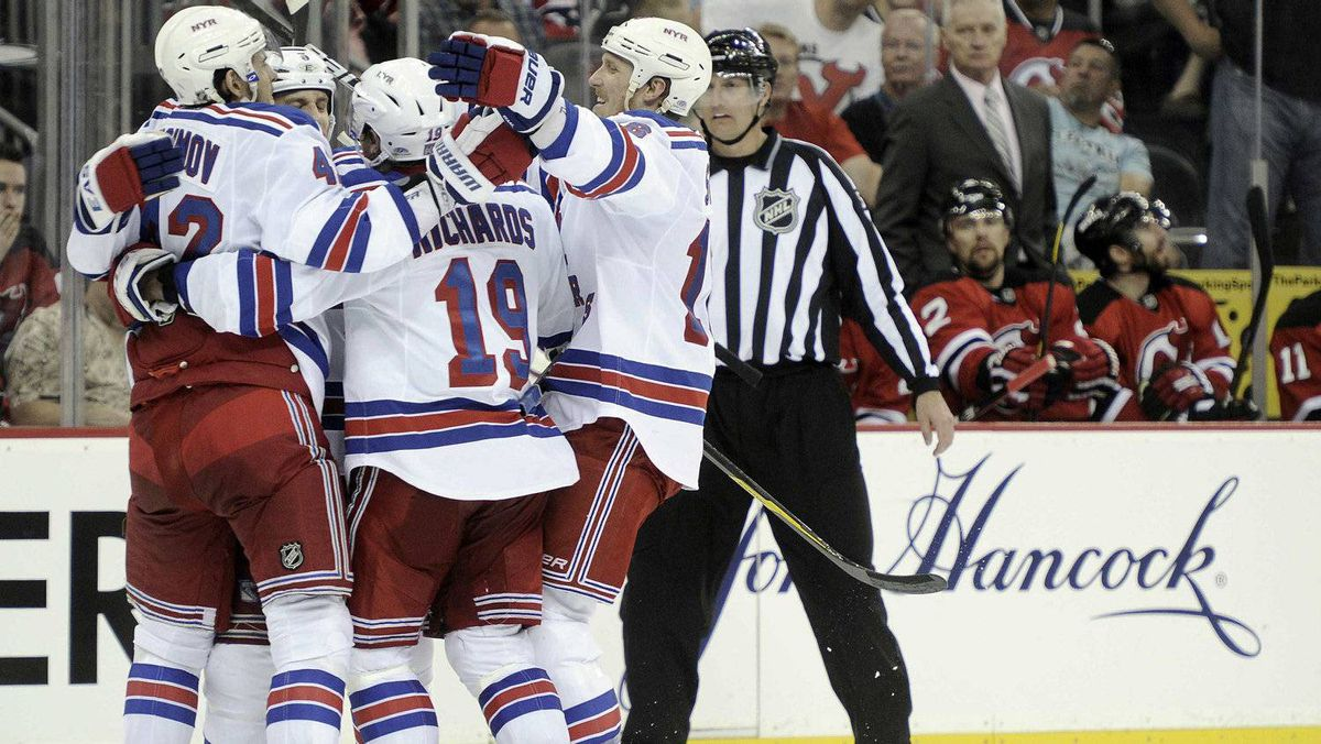 Members of the New York Rangers celebrate a goal by Dan Girardi (hidden) on the New Jersey Devils during the third period in Game 3 of their NHL Eastern Conference Final in Newark, New Jersey, May 19, 2012.