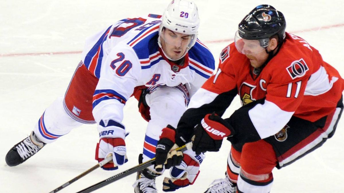 Ottawa Senators' Daniel Alfredsson fights for the puck with New York Rangers' Chris Kreider during the third period of game six of first round NHL Stanley Cup playoff hockey action at the Scotiabank Place in Ottawa on Monday, April 23, 2012. THE CANADIAN PRESS/Sean Kilpatrick