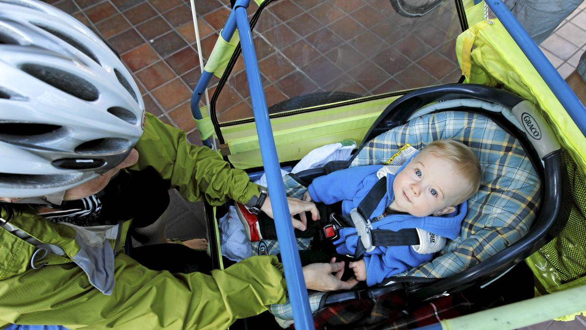 Amanda Beernink buckles up her son Tayo, 9 months, to go for an early bike ride Thursday morning in Vancouver, BC. Photo: Laura Leyshon for the Globe and Mail